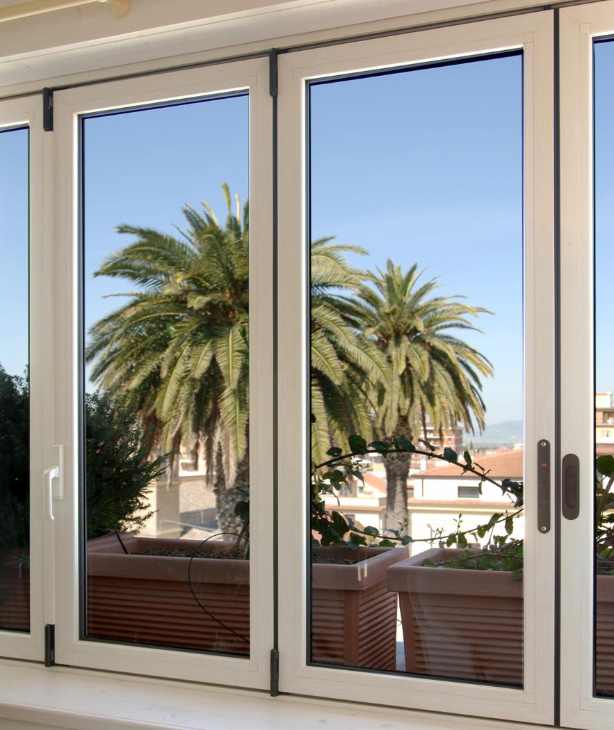 Verande domal verande renna infissi realizzazione - Porte finestre a libro ...